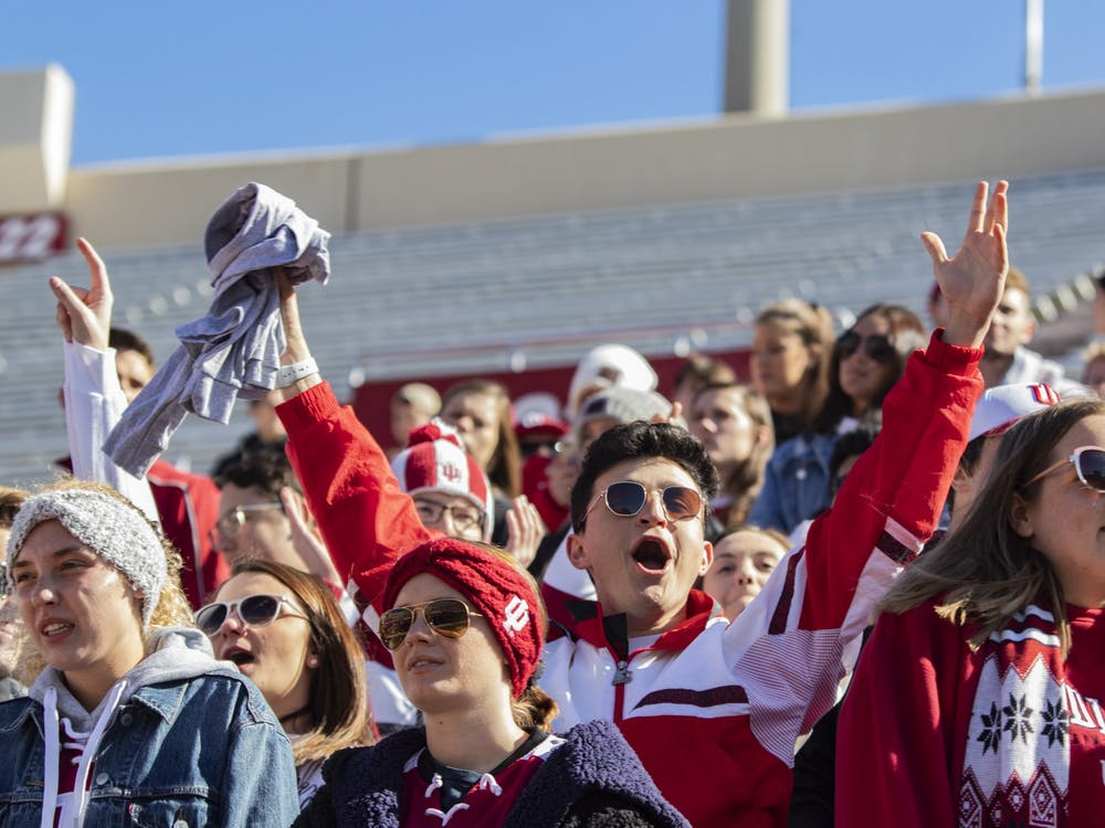 An IU football fan cheers after catching a free shirt before a football game Oct. 12, 2019, in Memorial Stadium. Big Ten fall sports were postponed Aug. 11 until the spring semester.