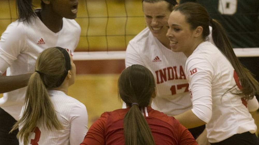 IU's volleyball team celebrates after winning a point during their game vs. Michigan State on Sept. 26 in Bloomington.