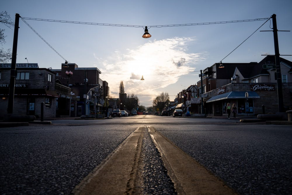 <p>A near-empty Kirkwood Avenue is pictured April 8 by the Sample Gates. </p>
