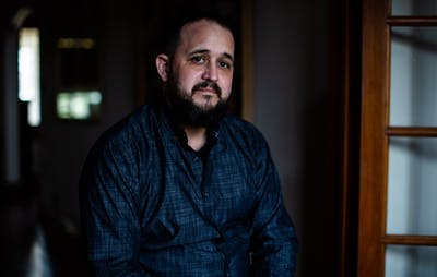 Brandon Drake sits in his Bloomington home March 19. He alleges that 2019 Bloomington mayoral candidate Amanda Barge sexually harassed him for over a year.