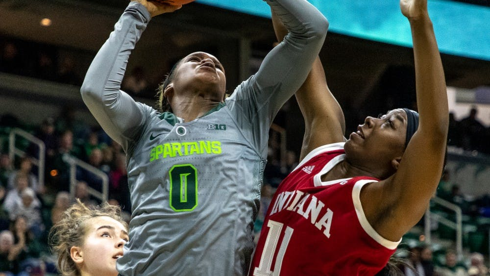 Senior forward Kym Royster attempts to block Michigan State on Feb.11. The Spartans beat the Hoosiers 77-61.