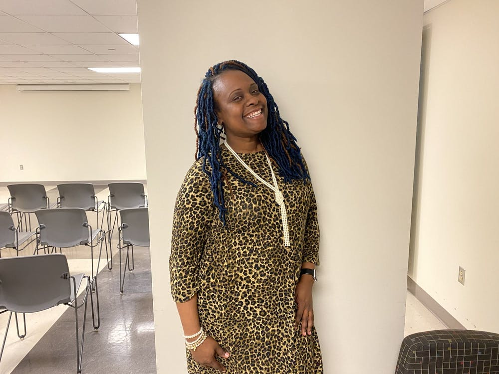 """Penn State director of diversity, equity and inclusion Abington Annesah Smith stands Feb. 4 in the Campus View Activity Room. Smith gave a presentation to IU students and faculty titled """"Creating Change Across Difference."""""""