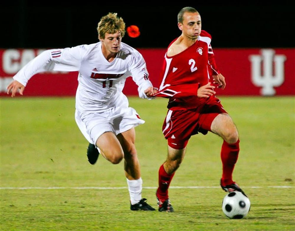 Sophomore midfielder Rich Balchan is held by Louisville's Brent Rosendall while moving the ball upfield during the Hoosiers 1-0 win over the Cardinals Wednesday night a Bill Armstrong Sadium.