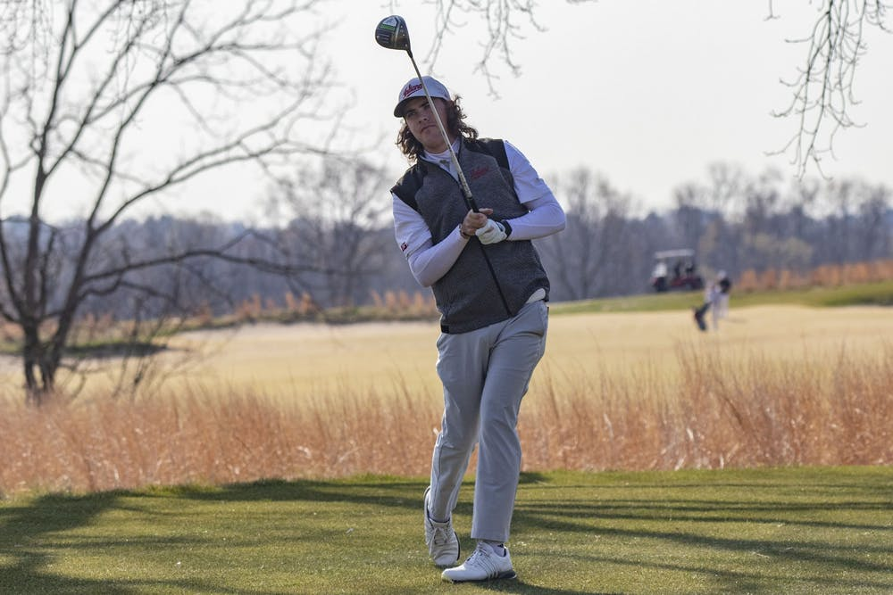 <p>Freshman Clay Merchant looks toward the green after hitting the ball during the Hoosier Collegiate Invitational on April 4, 2021, at the Pfau Course. The Hoosiers finished fifth Sunday in West Lafayette, Indiana, at the Boilermaker Invitational. </p>