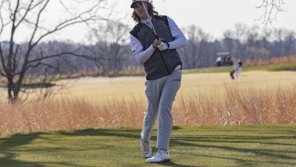 Freshman Clay Merchant looks toward the green after hitting the ball during the Hoosier Collegiate Invitational on April 4, 2021, at the Pfau Course. The Hoosiers finished fifth Sunday in West Lafayette, Indiana, at the Boilermaker Invitational.