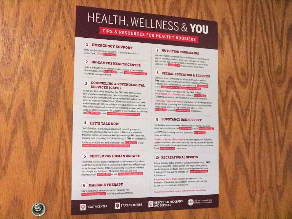 A sign that displays mental health information is posted to a door. Dr. Denise Hayes, the director of Counseling and Psychological Services, said in the past three years, there has been a 15% increase of students coming to CAPS and a 40% increase of students coming in for emergency services.