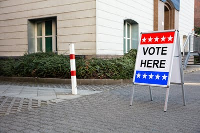"A sign that reads ""vote here"" is seen outside a polling place in Miami-Dade County in Florida."