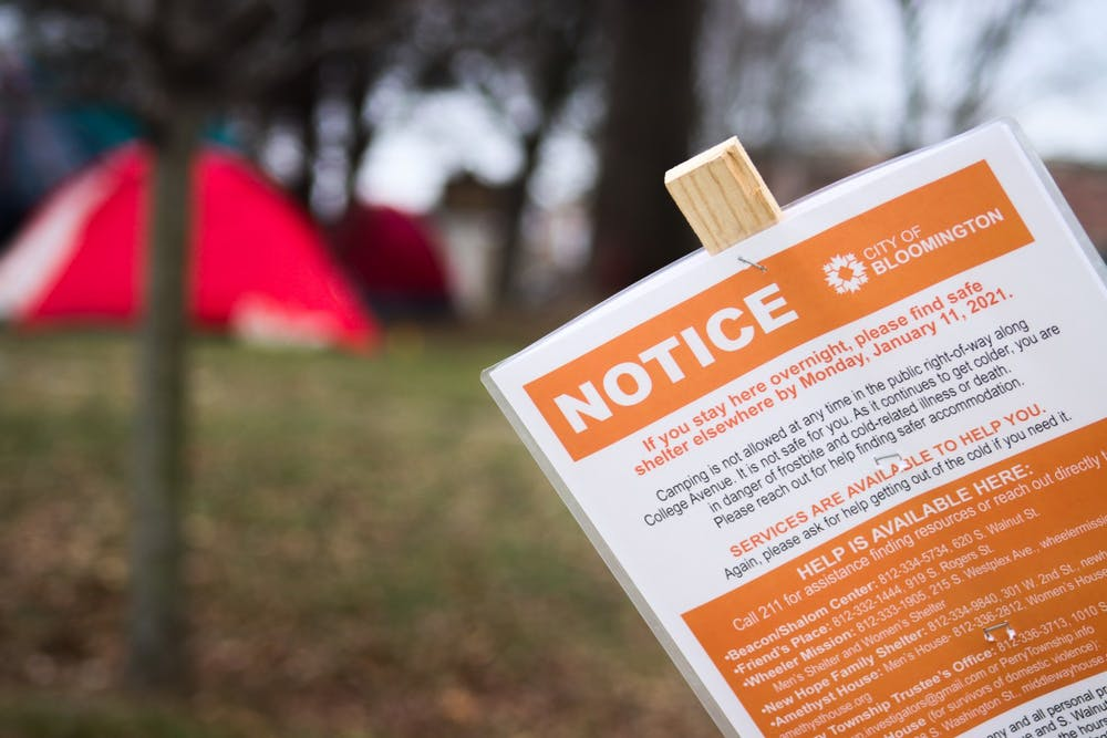 <p>A notice banning people from staying in shelters at Seminary Park appears on Jan. 10 at 100 W. 2nd St. Those using Seminary Park as a place to stay overnight are expected to move to a new location by Jan. 11.&nbsp;</p>