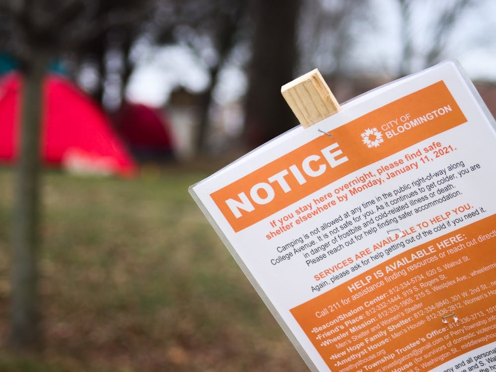 A notice banning people from staying in shelters at Seminary Park appears on Jan. 10 at 100 W. 2nd St. Those using Seminary Park as a place to stay overnight are expected to move to a new location by Jan. 11.