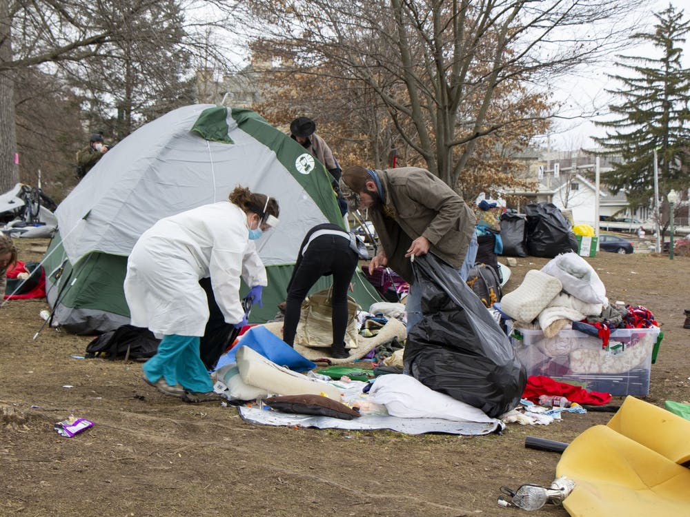 Bloomington residents gather belongings to move over to Seminary Park property Jan. 14. Many tents were on the easement of the property.