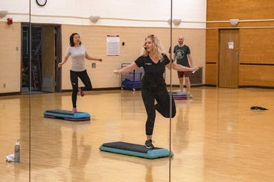 Cynthia Zaona leads a step class Jan 9 in the Intramural Center. The Intramural Center offers free group exercise classes for students.