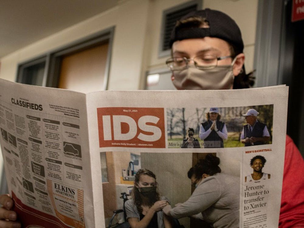 Summer Editor-in-Chief Luke Christopher Norton reads through an Indiana Daily Student newspaper.