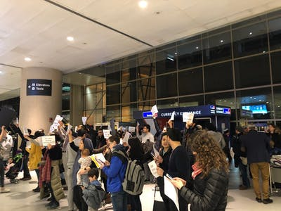 A group of protesters call for the release of Mohammad Shahab Dehghani Hossein, an Iranian citizen who was detained Jan. 19 at Boston Logan International Airport. He was returning to Boston for his spring semester at Northeastern University.