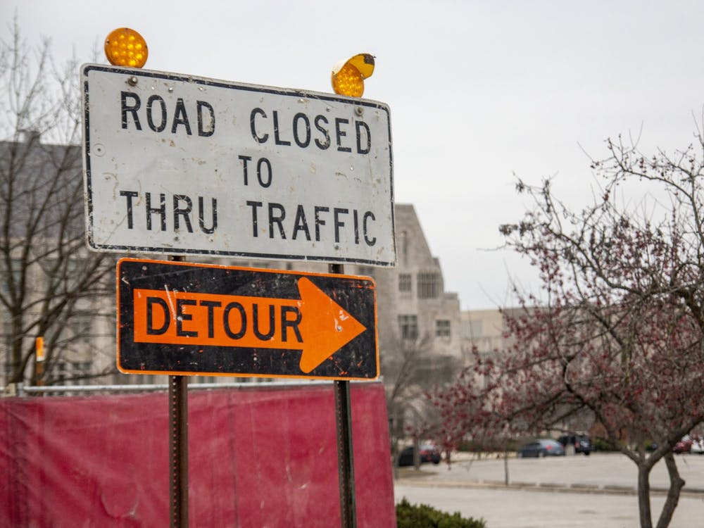 A sign directs traffic around a construction project Dec. 6 near Luddy Hall. The IU Board of Trustees approved a plan Friday to create a green space in what is currently the parking lot east of Luddy Hall.