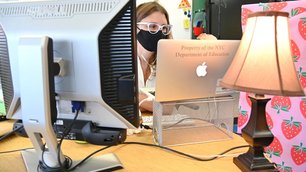 A teacher wears a mask and teaches remotely from her classroom on September 24, 2020, in New York City. Some IU students are hesitant to return to in-person classes and events after spending more than a year in a pandemic.