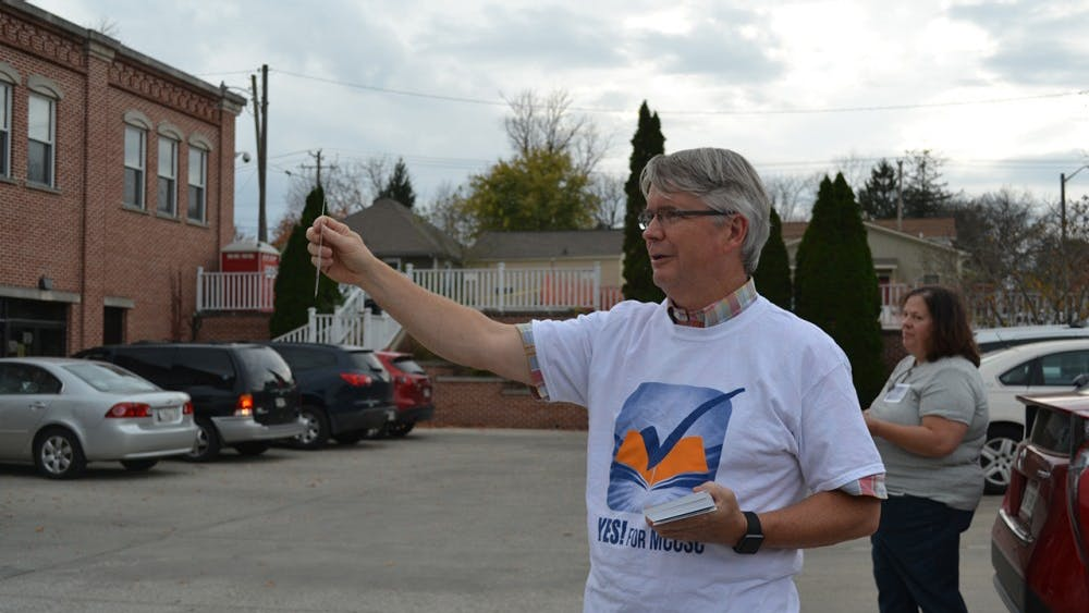 Mayor John Hamilton campaigns for the referendum outside Election Central on Wednesday night.