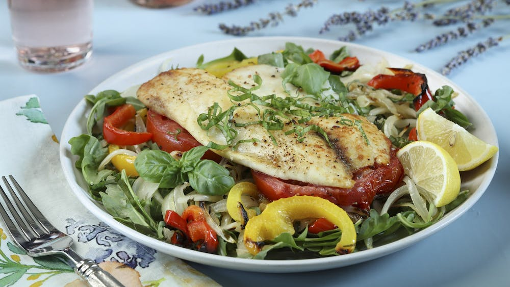 Cooked vegetables make a base for flaky fish in the pictured salad.