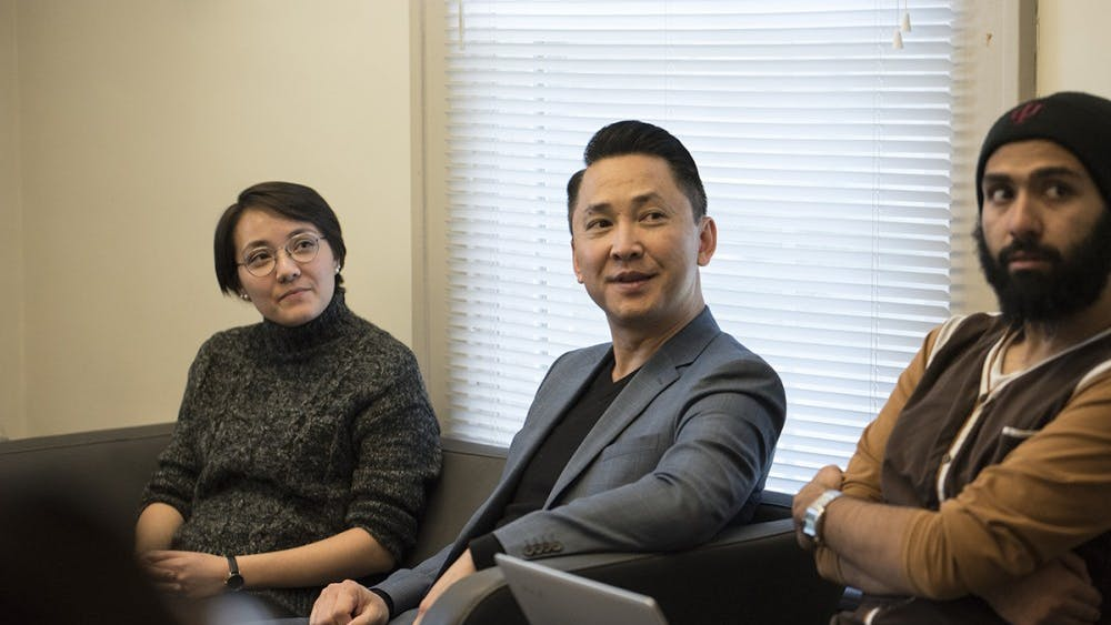 """Pulitzer Prize-winning author Viet Thanh Nguyen (center) speaks at the Asian Cultural Center Thursday as students packed the room around him. The discussion """"Over a Cup of Tea"""" centered around the affirmative action debate."""