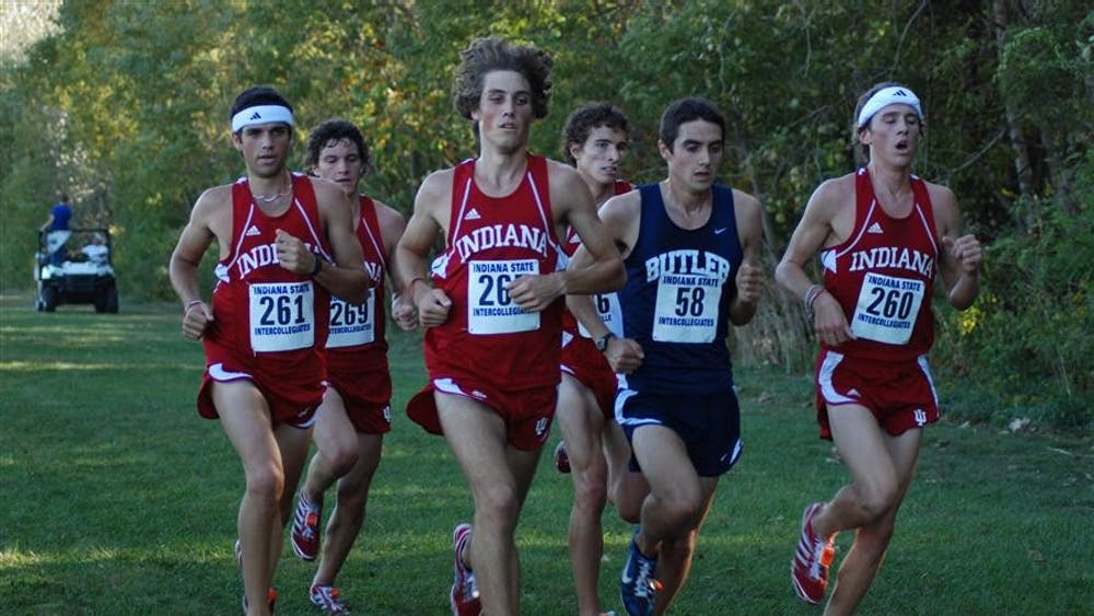 Sophomore Andrew Poore (center) leads a pack of Hoosiers and Butler's Rob Mullett at Indiana Intercollegiates on Friday evening in Terre Haute. Poore finished second behind Mullett, and the Hoosiers took the next four places to finish first as a team.