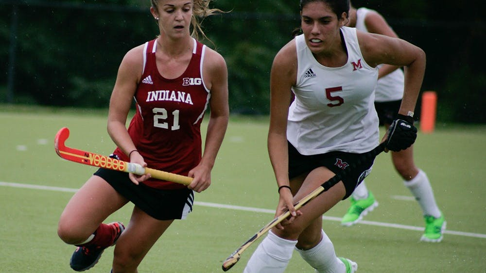 Sophomore Taylor Pearson, midfielder for Indiana, rushes for the ball against a Miami of Ohio player. The Hoosiers would go on to fall to Miami 3-1 on Friday, September 11th, at the IU Field Hockey Complex.