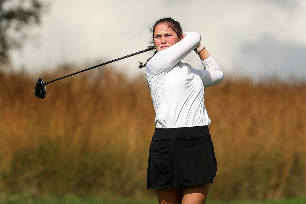 <p>Freshman Áine Donegan swings her club Oct. 5, 2021, at the Courtney Cole Invitational at Pfau Golf Course in Bloomington. Donegan beat her previous career high of 217 and finished tied for sixth at the<strong> </strong>Illini Invitational this week. </p>