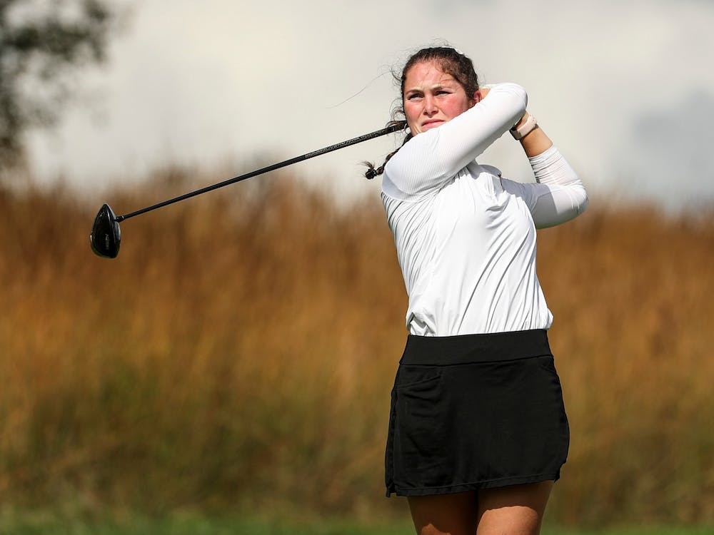 Freshman Áine Donegan swings her club Oct. 5, 2021, at the Courtney Cole Invitational at Pfau Golf Course in Bloomington. Donegan beat her previous career high of 217 and finished tied for sixth at the Illini Invitational this week.