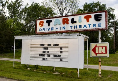 Movie times decorate a board May 22 at the Starlite Drive-In Theater. Tickets go on sale July 14 for the first act in a new series of drive-in movie theater concerts.