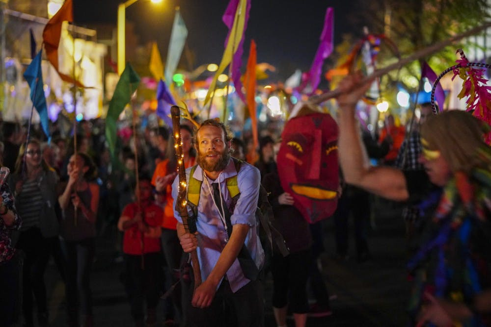 <p>The Lemon Bucket Orkestra brass band rests in the center of the Lotus Festival Parade as they march from Fourth and Washington streets to the Buskirk-Chumley Theater during the 2018 Lotus World Music &amp; Arts Festival on Sept. 29.</p>