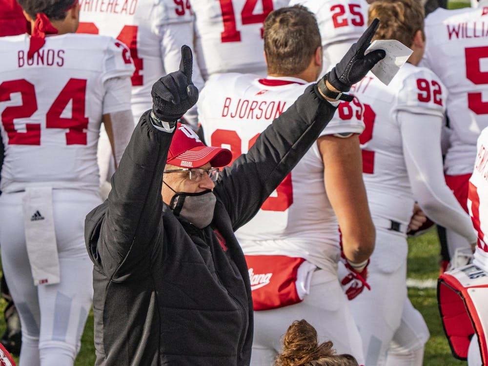 IU football head coach Tom Allen points into the air Nov. 14, 2020, in Spartan Stadium in East Lansing, Michigan.