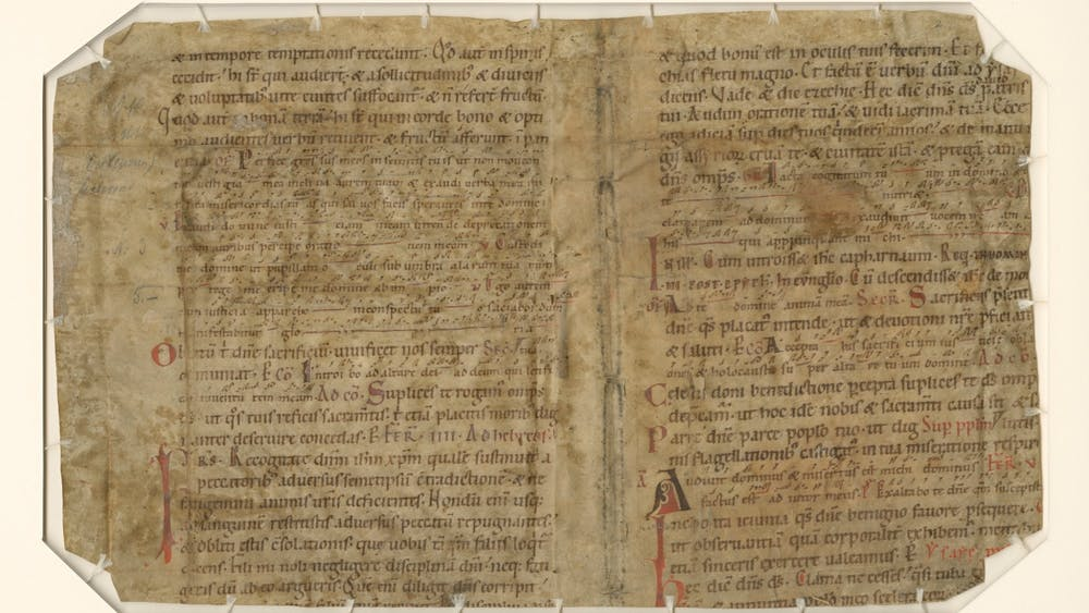 An example of a medieval manuscript in the Lilly Library collection sits on a table. IU received a three-year grant for the Peripheral Manuscripts Project: Digitizing Medieval Manuscript Collections in the Midwest.