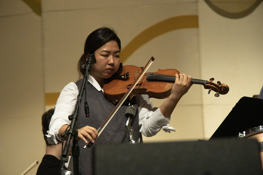 <p>Mary Eunkyung Chang performs a viola concerto with the IU Philharmonic Orchestra during a rehearsal Feb. 10 at the Musical Arts Center. The Philharmonic Orchestra will perform 8 p.m. Wednesday at the Musical Arts Center.</p>