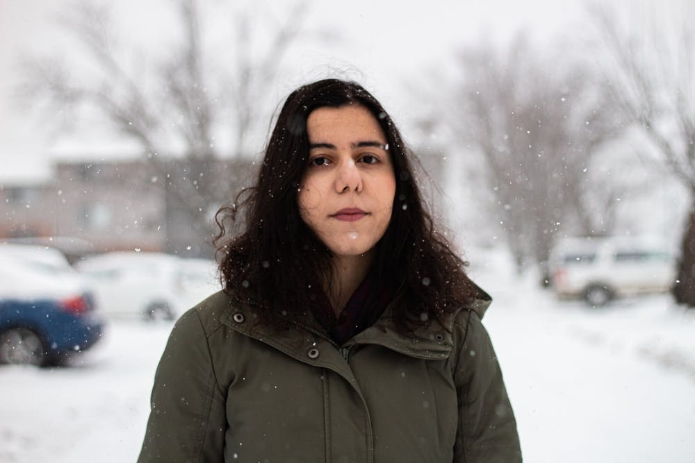 <p>Graduate student Despoina Panagiotidou poses for a picture Wednesday outside her apartment. Panagiotidou, 26, is a music theory doctoral student.</p>
