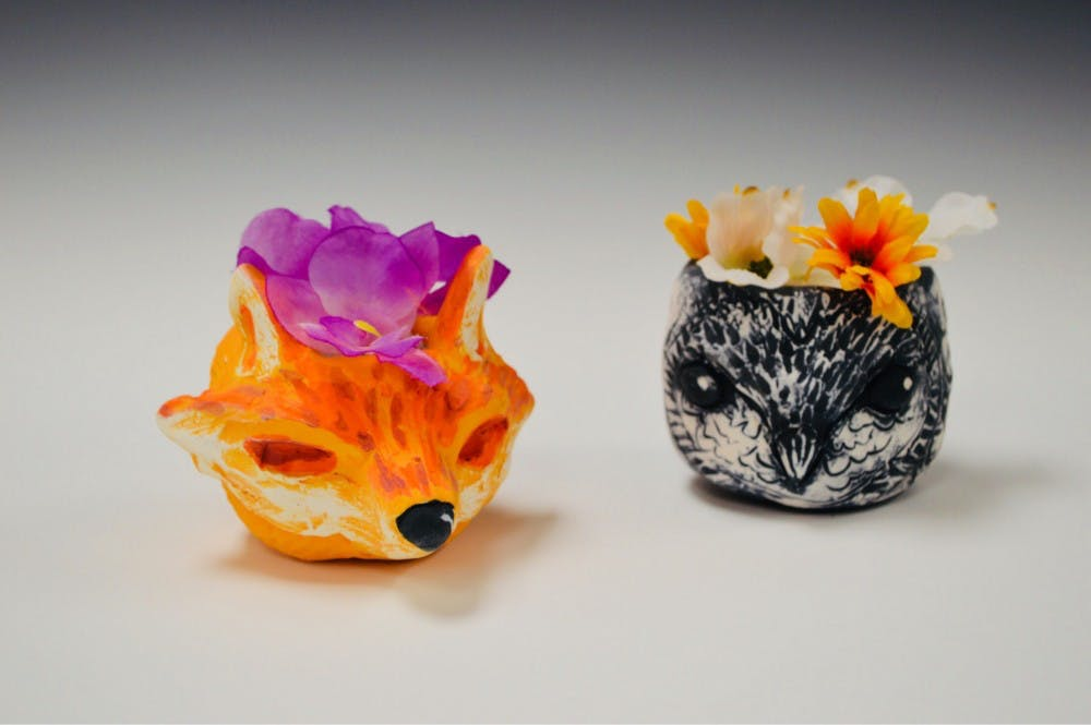 Gather.Lori Leaumont. Ceramic Animal Planter3