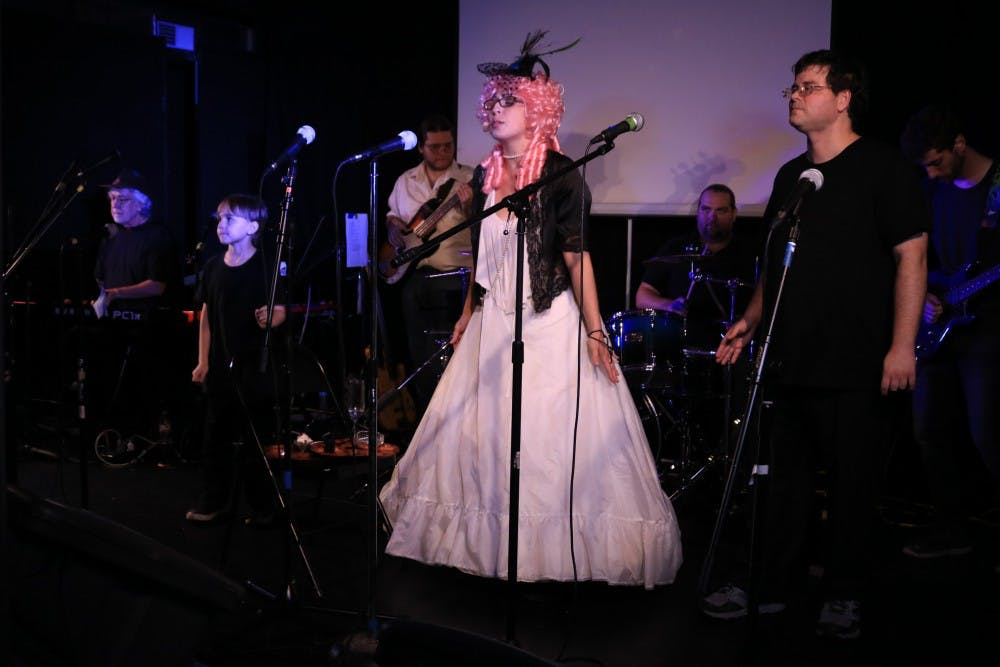 "<p>Mary Emma, center, and her son, Kingston Heaps, left, perform during the show ""Queen Cabaret"" on Friday night in the Artisan Alley. Mary also sang with another vocalist, Jeff Smith, for the song ""Killer Queen"" by Queen.&nbsp;</p>"