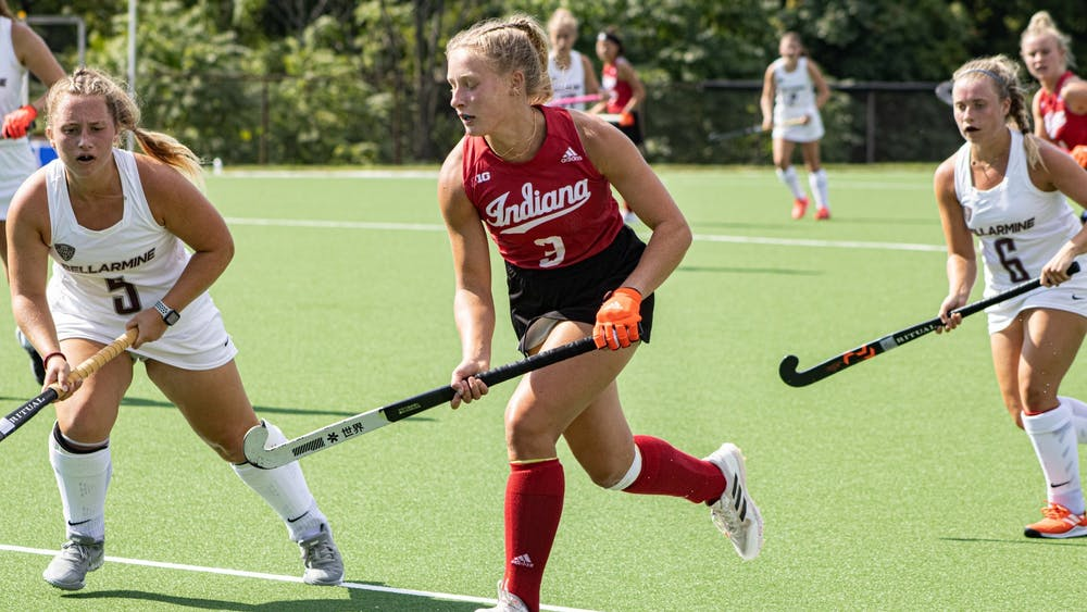 Freshman forward Kayla Kiwak runs with the ball during a match against Bellarmine University on Sept. 6, 2021, at the IU Field Hockey Complex. Indiana split games over the weekend against two ranked teams in Ohio State and Kent State.