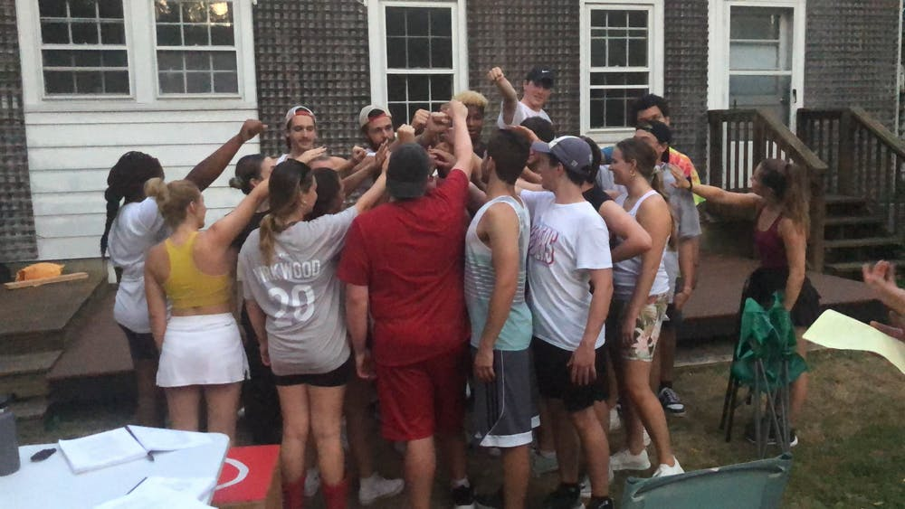 <p>The cast of &quot;Footloose&quot; huddles together after rehearsal. The cast has rehearsed for three hours every day Monday through Friday since July.</p>