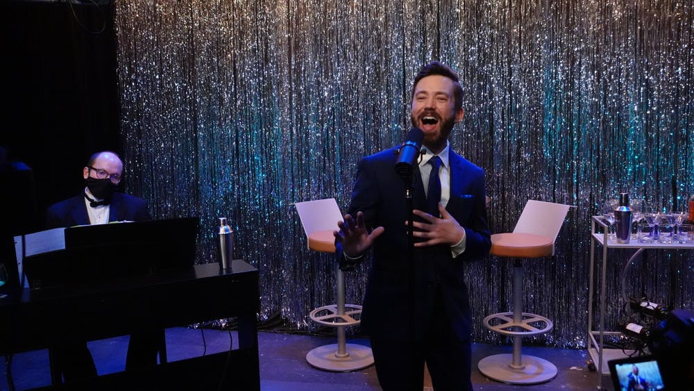 <p>Eric Shelley sings onstage alongside pianist Brandon Magid during the first Swing into Spring cabaret performance March 3 at Cardinal Stage. The event showcases solo and ensemble performance of famous big band jazz tunes from the swing music era. </p>