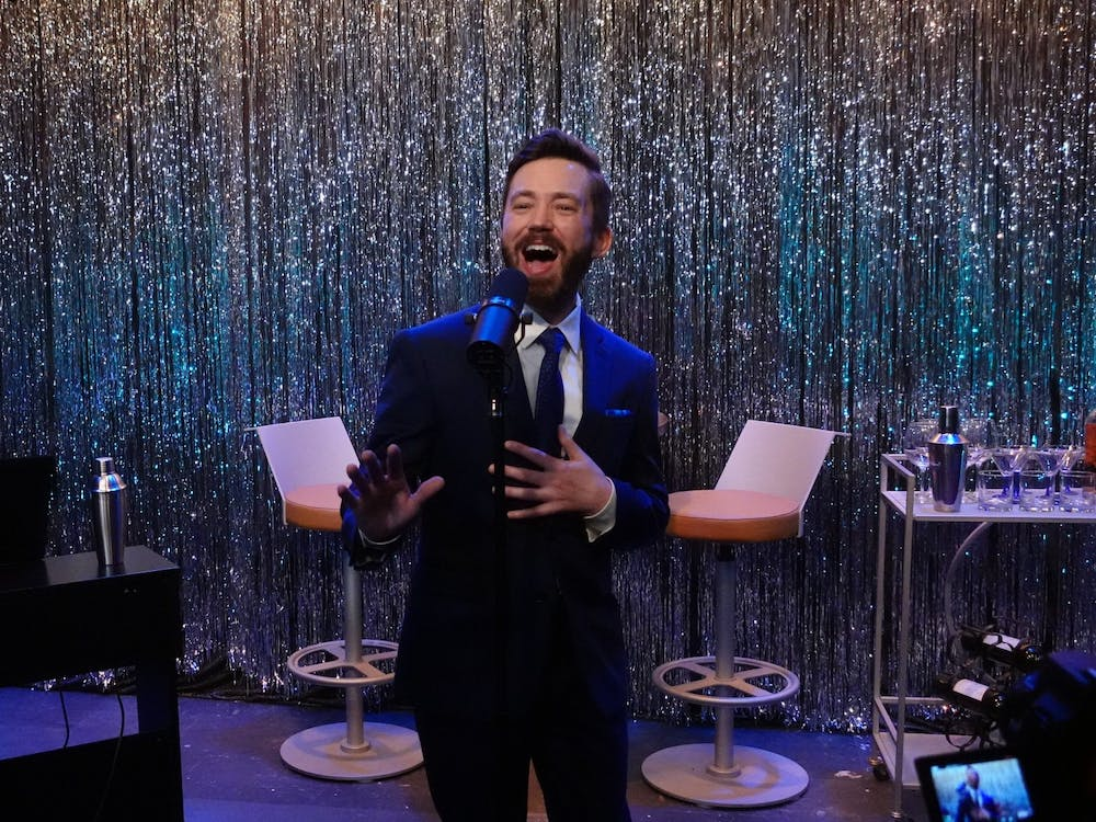 Eric Shelley sings onstage alongside pianist Brandon Magid during the first Swing into Spring cabaret performance March 3 at Cardinal Stage. The event showcases solo and ensemble performance of famous big band jazz tunes from the swing music era.