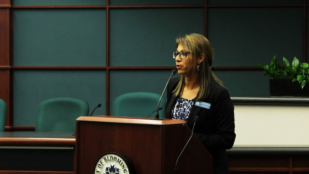 Latino Programs Coordinator Josefa Luce speaks during the Hispanic and Latino Affairs Awards Ceremony on Sept. 30 at Bloomington City Hall. The ceremony recognized outstanding members of the Latino community.
