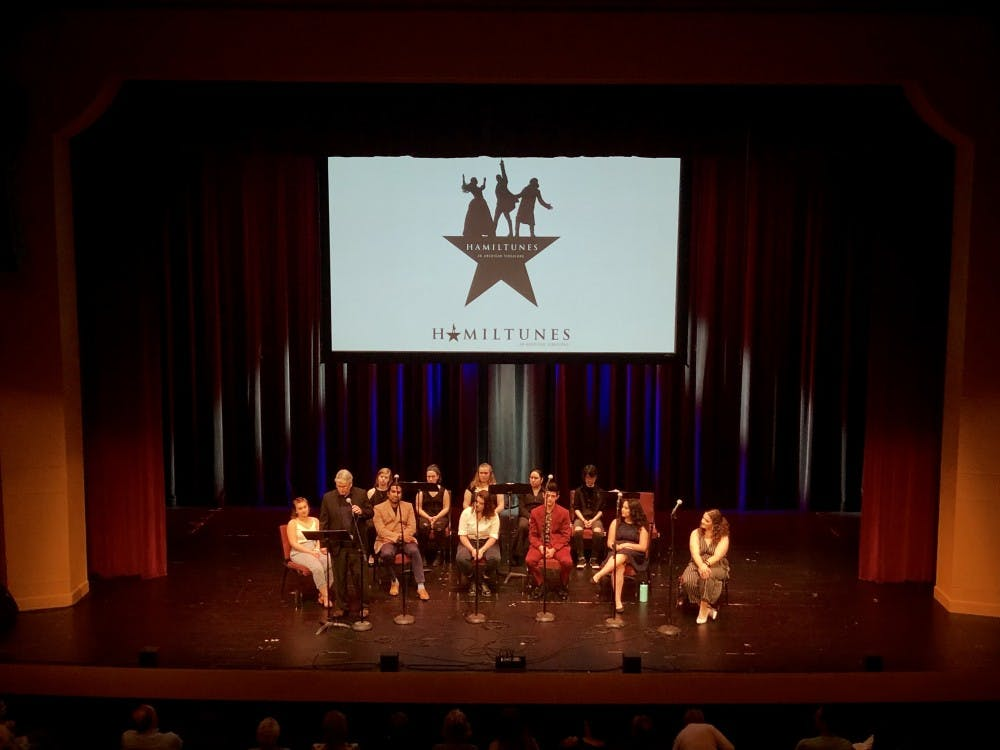 """Singers from the Jacobs School of Music, Singing Hoosiers and Department of Theatre, Drama and Contemporary Dance participate Thursday night in """"Hamiltunes,"""" a """"Hamilton"""" sing-along, at the Buskirk-Chumley Theater. A few members of the Bloomington High School North choir sang in the chorus, and Mayor John Hamilton came on stage to sing in a duet."""