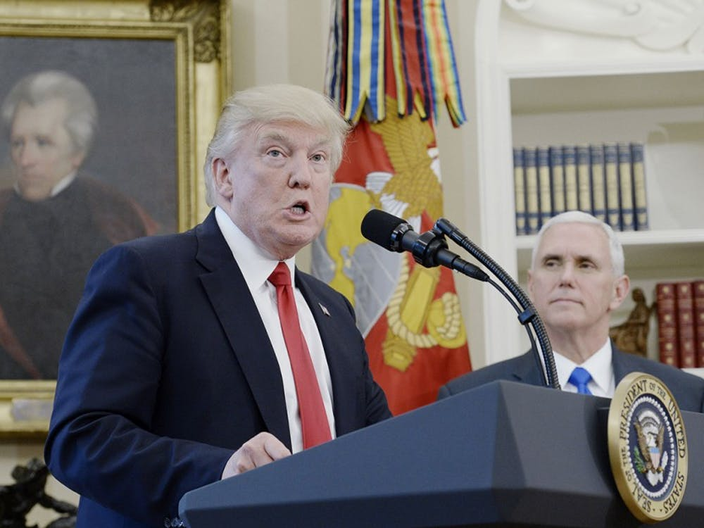 President Trump speaks about trade as Vice President Pence looks on before signing Executive Orders in the Oval Office of the White House March 31 in Washington, D.C.