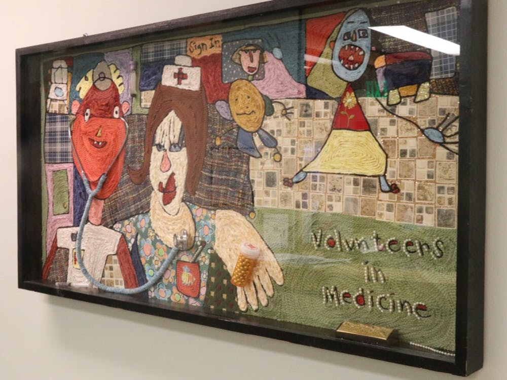 A piece of art is displayed in the Volunteers in Medicine office. The medical clinic is a viable option for people who don't have health insurance, including low-income families and undocumented immigrants.