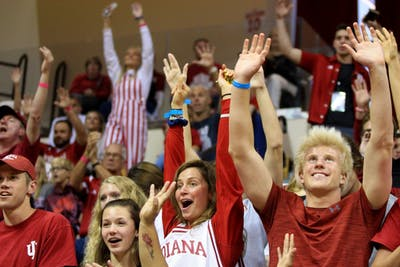 Students in the end zone of Simon Skjodt Assembly Hall raise their hands to show they want a T-shirt from Hoosier Hysteria.