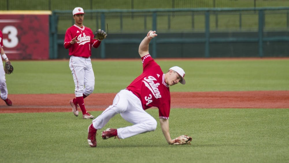 Junior pitcher Jonathan Stiever fields a ball during the April 6 loss to Purdue at Bart Kaufman Field. Stiever pitched 6.2 innings as IU lost to Illinois on Friday night.