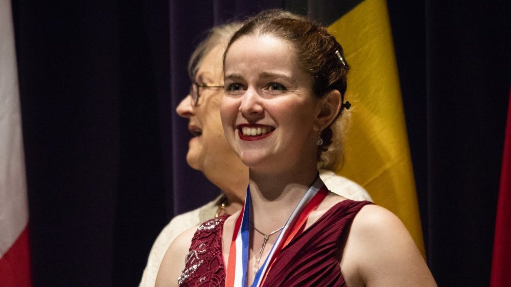 Mélanie Laurent, 23, smiles through her tears during the awards ceremony July 13 in the Musical Arts Center. Laurent earned first place along with $6,000 and a Lyon and Healy Concert Grand Harp in the USA International Harp Competition.