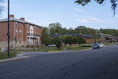 Students sit outside of Phi Mu sorority house Saturday evening. Phi Mu was nationally founded in 1852.