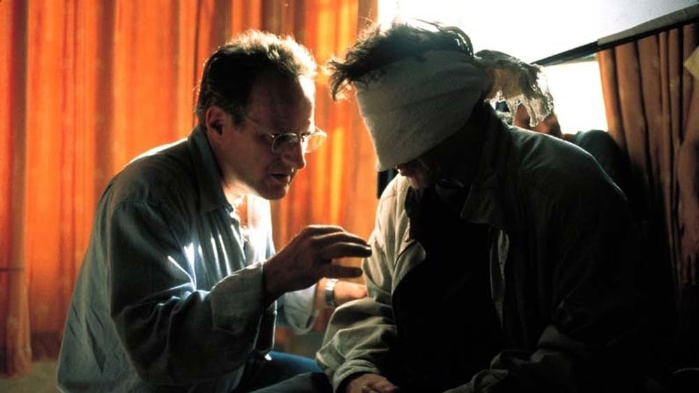 "Director Michael Mann, left, talks with actor Al Pacino, right, on the set of ""Insider."" The movie, released in 1999, is based on the 60 Minutes segment about tobacco-industry whistleblower Jeffrey Wigan."