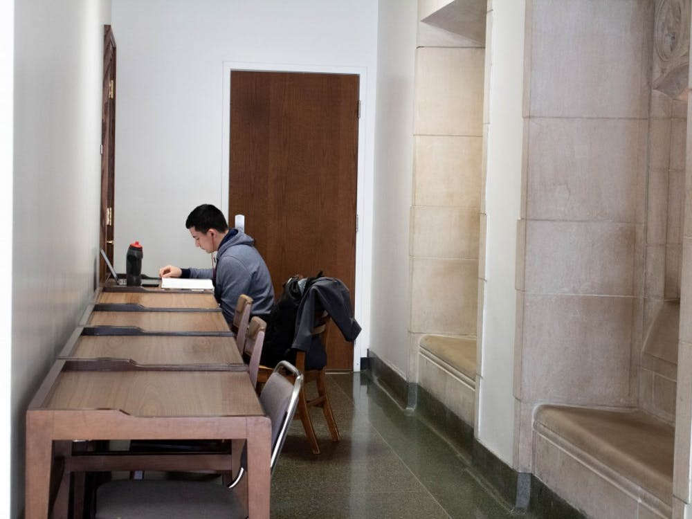 """Asael Nunez studies in a hallway above Alumni Hall in the Indiana Memorial Union. Yesterday marked the beginning of the last week of classes before finals, commonly known as """"dead week."""""""