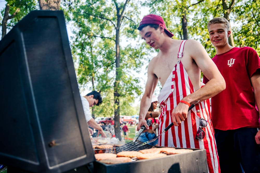 <p>Sophomore Steven Alton cooks hamburgers on a grill during his first tailgate before the Indiana home football game against the University of Idaho on Sept. 11, 2021, at the Indiana Tailgate Fields. &quot;I loved the energy and camaraderie amongst current, past, and future students,&quot; Alton said. &quot;I couldn&#x27;t have asked for a better way to kick off the year.&quot;</p>