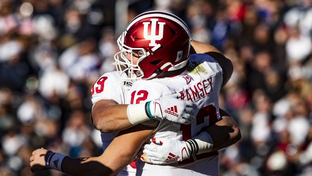 Sophomore tight end Matt Bjorson hugs junior quarterback Peyton Ramsey after scoring a touchdown Nov. 16 at Beaver Stadium. Ramsey scored in the fourth quarter.